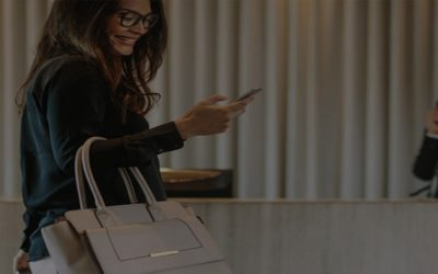 a women checking into an hotel during covid-19. improving digital experience for hospitality industry